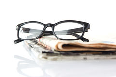 Glasses and newspapers Royalty Free Stock Images