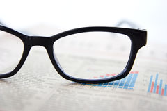 Glasses and newspapers Stock Image