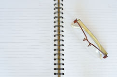 Glasses and note book. Glasses and white open note book Stock Photo