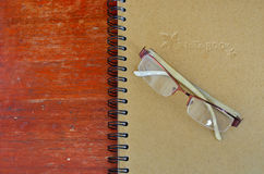Glasses and note book Stock Images