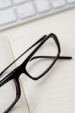 Glasses and notebook Stock Photo
