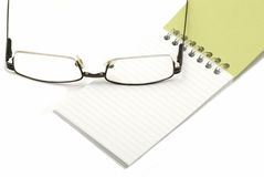 Glasses with notebook Royalty Free Stock Images