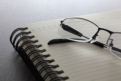 Glasses and notebook. On the wood table Stock Photo