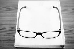 Glasses on notebook black and white color tone style Royalty Free Stock Photography