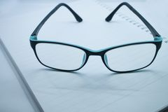 Glasses and notebook royalty free stock image