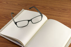 Glasses on notebook Royalty Free Stock Photography