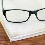 Glasses on notebook Royalty Free Stock Images
