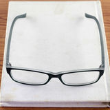 Glasses on notebook Royalty Free Stock Photos