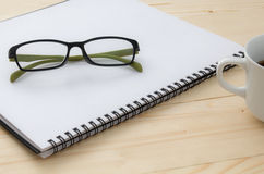 Glasses on notebook Stock Image