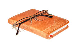 Glasses on the notebook Royalty Free Stock Photos