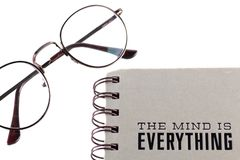 Glasses and notebook isolated on white background. Royalty Free Stock Photo