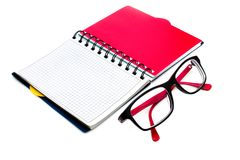 Glasses and notebook isolated on white Royalty Free Stock Photography