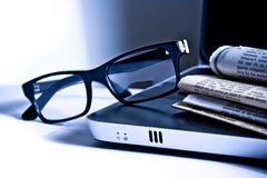 Glasses on notebook Stock Photography