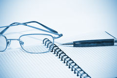 Glasses, notebook and the pen Royalty Free Stock Image