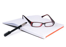 Glasses, notebook and pen Royalty Free Stock Photo