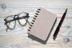 Glasses and notebook Stock Photography