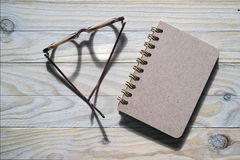 Glasses and notebook Stock Images