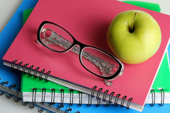 Glasses with notebooks Stock Photos