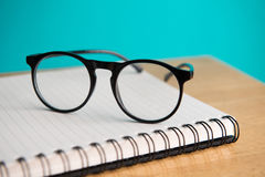 Glasses & Notepad. Eye glasses, blank notepad, and mechanical pencil on the table royalty free stock photo