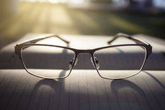 Glasses on notepad Stock Image