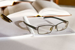 Glasses on Notepad. Glasses on an open notepad royalty free stock photos