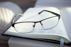 Glasses on notepad Royalty Free Stock Images