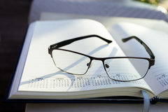 Glasses on notepad Stock Photography