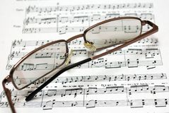 Glasses on notes stock image