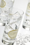 Glasses objects with soda water and ice cubes Stock Photos