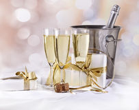 Glasses Of Champagne And Gifts Royalty Free Stock Photography