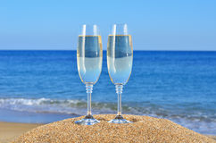 Free Glasses Of Champagne On The Beach Sand Stock Images - 27932384