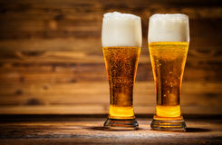 Free Glasses Of Lager Served On Old Wooden Planks, Stock Photos - 82295323