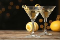Free Glasses Of Lemon Drop Martini Cocktail With Zest On Wooden Table Against Blurred Background Stock Photo - 158499990