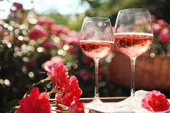 Free Glasses Of Rose Wine On Table In Blooming Garden Royalty Free Stock Image - 153933356