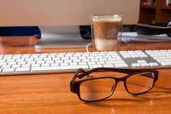 Glasses on an office desk. Royalty Free Stock Photo