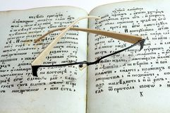 Glasses on old books. Glasses on antique books stock photo