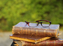 Glasses and old books. Pair of old glasses on some old books Royalty Free Stock Photo
