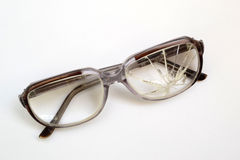 Glasses. Old glasses with broken glass on a white background Stock Photos