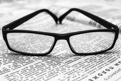 Glasses on old newspaper Royalty Free Stock Image