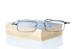Glasses on old used books. Royalty Free Stock Photo