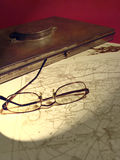Glasses On A Map Stock Images