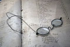 Glasses On Top Of A Book Stock Photos