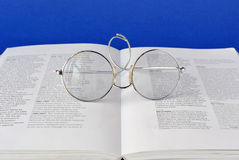 Glasses onbook Royalty Free Stock Photos