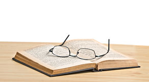 Glasses on open book Royalty Free Stock Photos