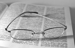 Glasses on an open book Royalty Free Stock Images