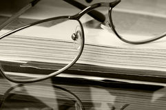 Glasses on the open book Royalty Free Stock Images
