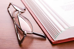 Glasses and open book Stock Images