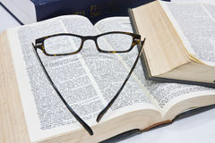 Glasses on open book Stock Photos