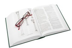 Glasses on the open book Stock Photo