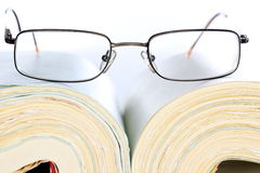 Glasses on a open book Royalty Free Stock Images